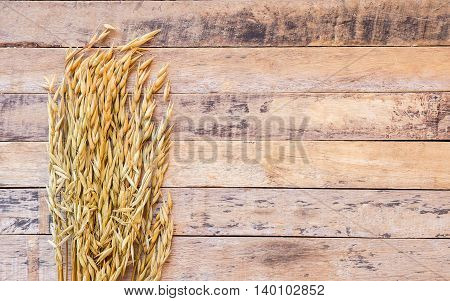 Wheat on the old wooden table background. top view with copyspace
