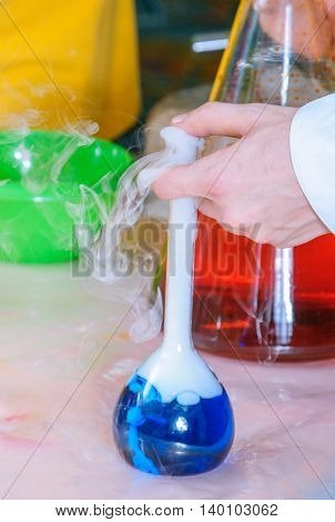 Chemical blue liquid in chemical flasks. Laboratory equipment. Cryo show
