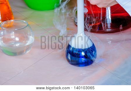 Laboratory equipment. Cryo show. Chemical blue liquid in chemical flasks.