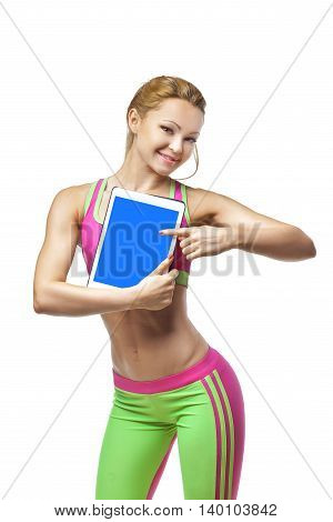 Happy fitness woman showing blank tablet computer screen isolated on a white background