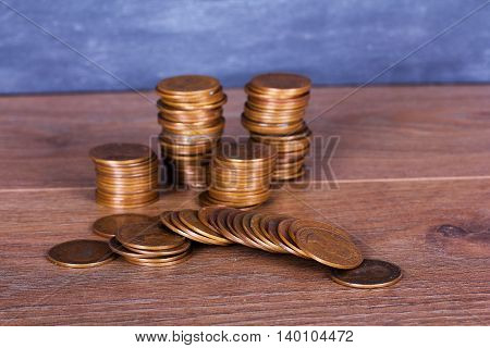 Stack of old penny coins on a wooden surface