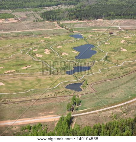 Aerial Views - Russia. Golf club - golf courses paths reservoirs. Shooting from the helicopter.