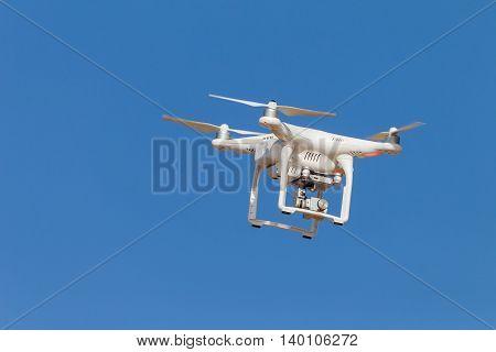 Drone aircraft remote video camera in blue sky closeup.