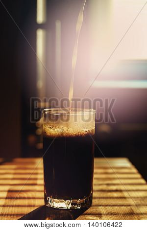 Milk Pouring In Coffee Drink