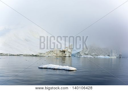 Icebergs are on the arctic ocean to Ilulissat fjord in Greenland
