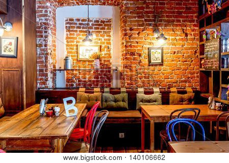 Moscow, Russia - April 12, 2016: cafe interior brick wall and tables