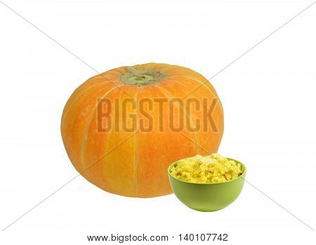 Bright green ceramic bowl full of millet porridge with pumpkin filling, poured melted butter on top, standing next to huge orange pumpkin. Isolated on white background