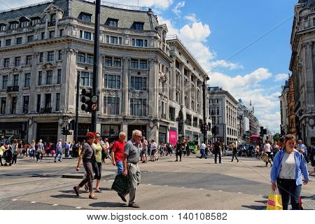 LONDON - JULY 1 2014: Oxford Circus with unidentified people in London. Up to over 40.000 pedestrians per hour pass the junction it is the highest pedestrian volumes recorded in London.