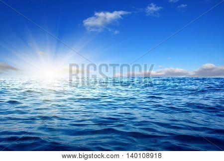 Blue sea and sun on sky