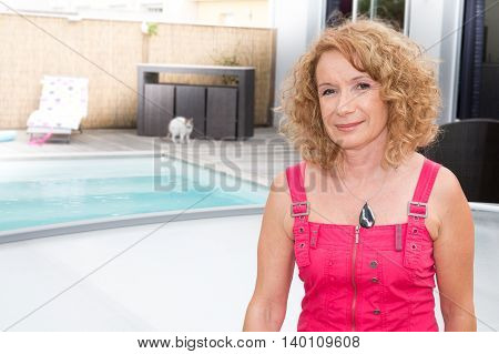 Girl In The Swimming Pool In Front Of Her House