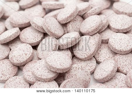 Closeup look to pile of cranberry nutritional supplement pills with selective fokus
