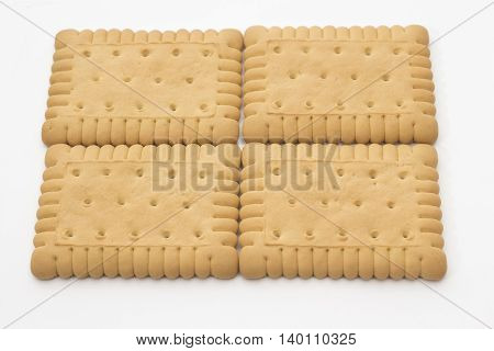 Composition of  four biscuits arranged on a white background