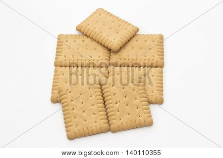 Composition of biscuits arranged on a white background