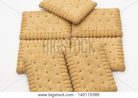 Several biscuits arranged on a white background