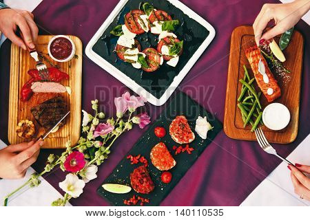 A Beautiful Decorated Table In The Restaurant With Delicious Dishes. The Concept Of A Romantic Dinne