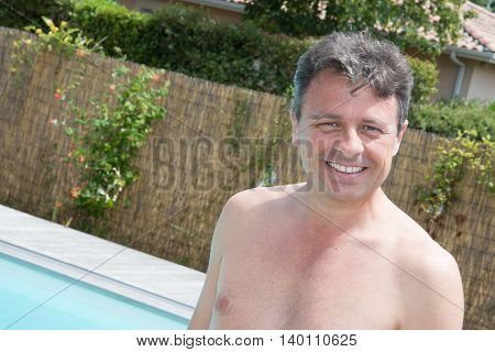 Close Up Portrait Of A Handsome And Happy Mid Aged Man Relaxing
