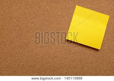 Yellow Sticky Note Stuck On Cork Board