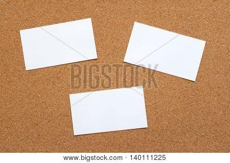 Three Blank Cards On A Cork Board