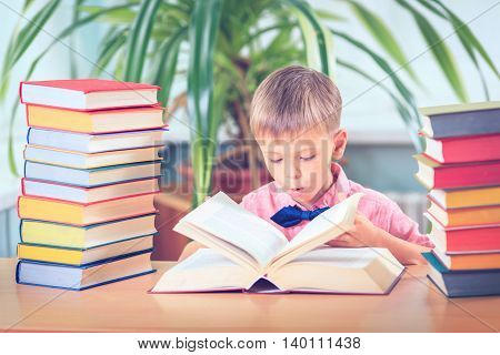 School Child Boy in Glasses Think in Classroom Kid Primary Students Reading Book Pupil Learn Lesson and Dream Education