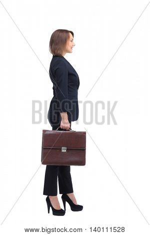 Profile of businesswoman handing suitcase, isolated on white