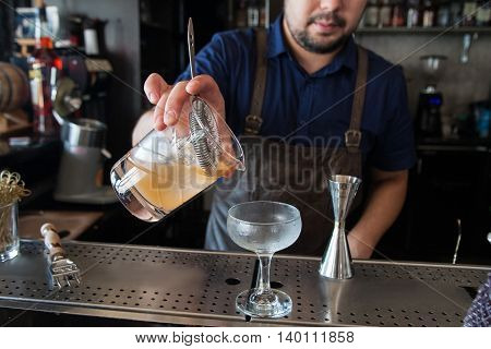 Bartender Poured Into A Glass