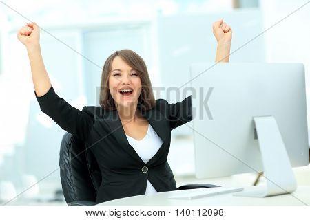 Exited, successful business woman looking at camera