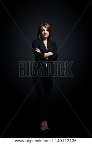 Full-length portrait of businesswoman  isolated on black background