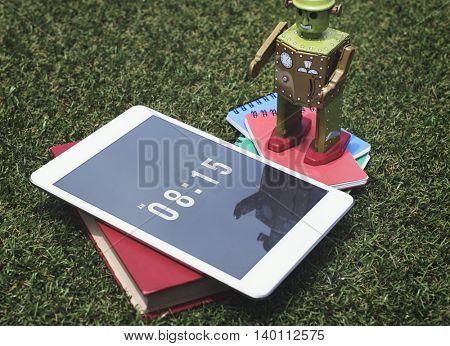 Tablet Robot Books Grass Concept