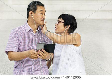 Senior Couple Mobile Earphones Concept