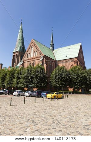 Meldorf, Germany - July 20, 2016: St.-Johannis church at the central square. Though a protestant church, the 13th century brick-gothic building is referred to as ??Meldorf Cathedral??.