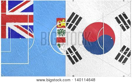 Flags of countries participating to the football tournament. Football field textured by Fiji and Korea national flags.3D rendering