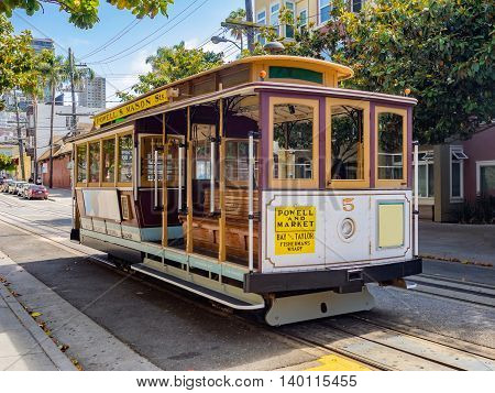 Public cable cars in San Francisco streets USA