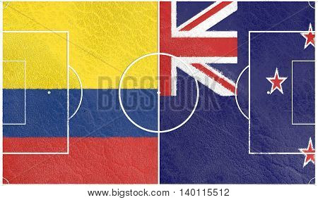 Flags of countries participating to the football tournament. Football field textured by Colombia and New Zealand national flags. 3D rendering