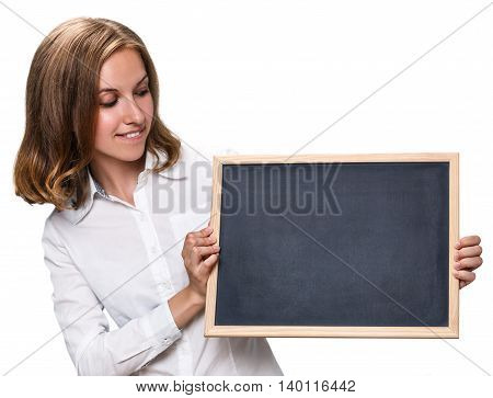 Young pretty girl holding and presents chalkboard with copyspace