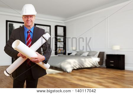 Architect with blueprints in front of a modern bedroom