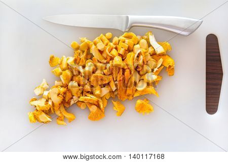Sliced golden chanterelle fungus on the cutting board