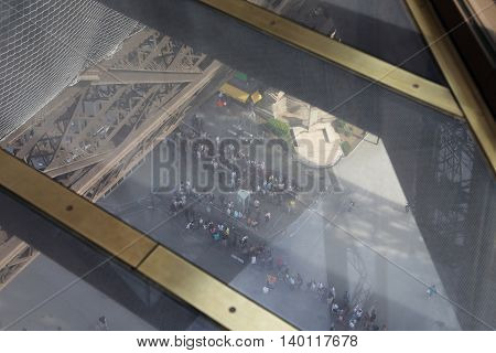 PARIS, FRANCE - MAY 12, 2015: This is part of the first floor of the Eiffel Tower with a glass floor at a height of 57 meters.