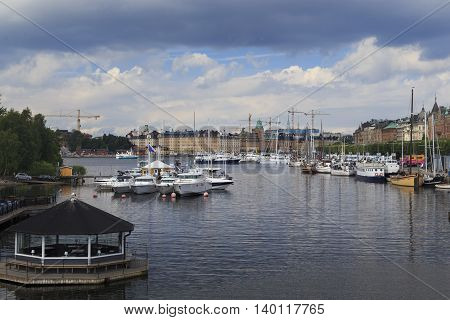 STOCKHOLM, SWEDEN - JUNE 28, 2016: These are berths with boats and yachts along the waterfront Strandvegen.