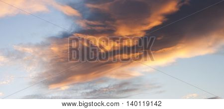 Dramatic sunset sky with beames of light through clouds