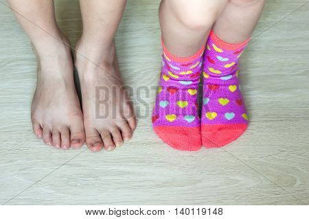 Two pairs of children legs closeup with socks