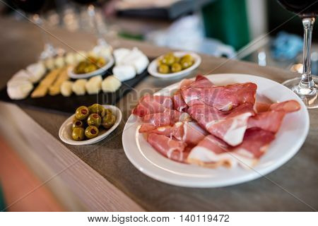 High angle view of meat and food on table in restaurant