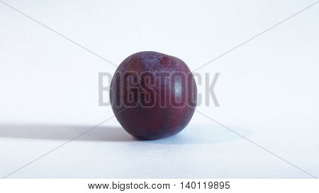 Ripe and juicy plums on a white background