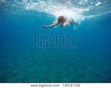 man swim in the sea