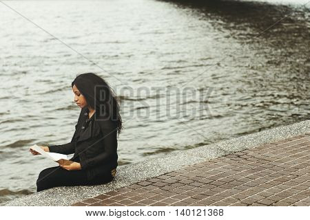African Girl Sitting Reading Letter River Concept