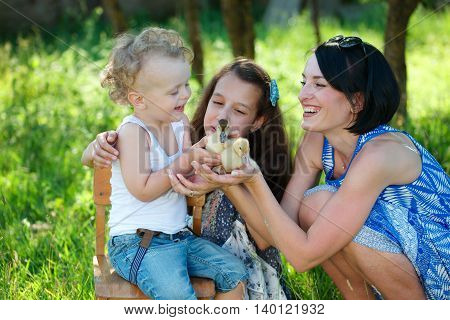 happy family with little yellow duckling in summer Park