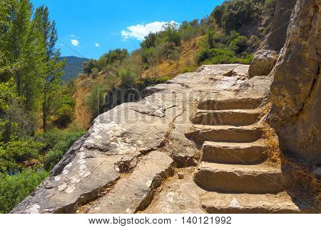 Rocky stairway above Cueva del Gato - a famous natural cave in Benaojan (Ronda Spain).