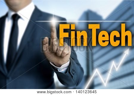 Fintech touchscreen is operated by businessman background