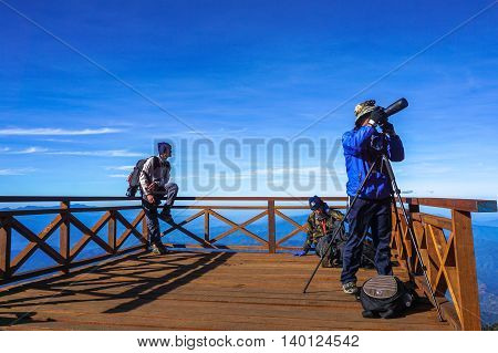 Mount Kinabalu,Ranau,Malaysia-March 13.2016:Group of photographers taking pictures the amazing view of the Ranau and Kundasang town from viewpoint Mount Kinabalu.