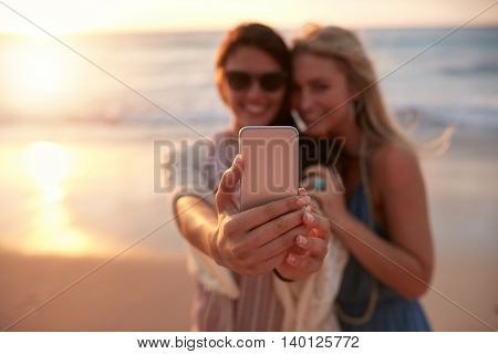 Female Friends Taking Selfie With Beach Sunset