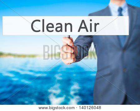 Clean Air - Businessman Hand Holding Sign